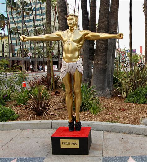 A Gold Life-Size Crucifixion Sculpture Of Kanye West